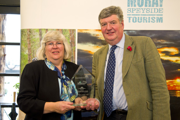 Photograph Northern Scot Ian Widdowson and Joanna Taylor, two of Forres Events Ltd's directors, receiving the award.
